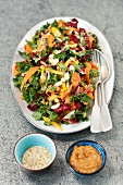 Kale salad with chicory, yellow pepper, carrot and peanut butter dressing