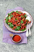 Spinach salad with chickpeas and bacon fried with garam masala