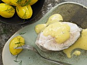 Steamed cod with mustard sauce and salted potatoes