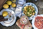 Buffe outdoors with fresh potatoes, shrimp and lemon