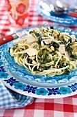 Pasta with pesto, parmesan and pine nuts