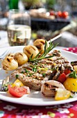 Grilled meat, potatoes and vegetables