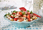 Salad with couscous, strawberries, cheese, lettuce, hazelnuts, ham and bread croutons