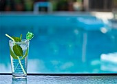 Mojito cocktail by swimming pool