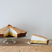 Banana cream pie, cut into pieces