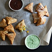 Sweet and savoury samosas with different dips