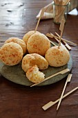 Brazilian cheese balls with wooden skewers