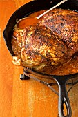 Turkey in iron pan with spicy sauce