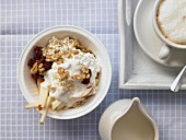 Oatmeal with fruit, nuts and fresh cheese