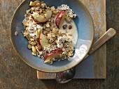 Amaranth and oat muesli with nuts and nectarine slices