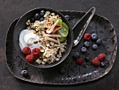 Fruity bircher muesli with apples, grapes, berries, sultanas and hazelnuts
