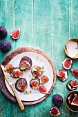 Buckwheat blinis with bacon cream and figs
