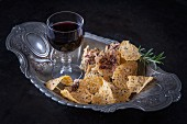 Cheese crisps and a glass of red wine