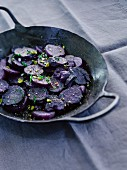 Vitelotte potatoes in a frying pan