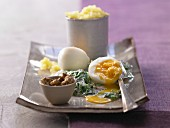 Quick dinner of boiled eggs with spinach and tarragon