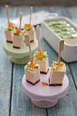 Terrine cubes with cucumber and salmon caviar