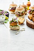 Fish Sliders with pickled cucumber and red onion