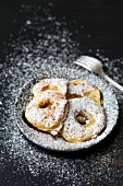 Baked apple rings with icing sugar
