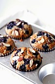 Blueberry muffins with flaked almonds