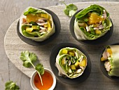 Stuffed rice paper rolls with turkey breast, peppers, orange and coriander