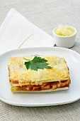 A serving of vegetable lasagne with chard