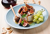 Figs, honey and camembert cheese.