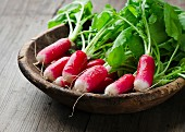Fresh radishes on a wooden board