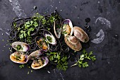 Seafood pasta with clams Spaghetti Vongole on dark marble background