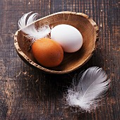 Eggs in bowl on wooden background