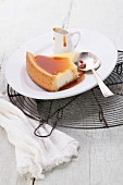 Classical Cheesecake and caramel Sauce on plate on blue texture background