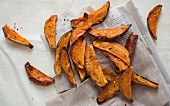 Top view scattering of sweet potato wedges with Chilli