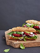 Beetroot burger with avocado cream and feta cheese