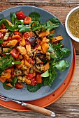 Sweet potato salad with aubergines, peppers and sesame seeds
