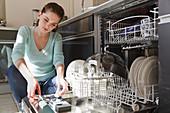 Woman using wash crockery