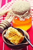 Beautiful honey comb, spoon and honey in jar