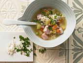 Potato and vegetable soup with smoked pork and horseradish