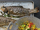 Baked trout with a spicy avocado and corn salad