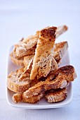 Toasted bread strips on a plate