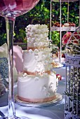 Three tier wedding cake on a garden table
