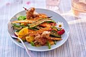 Fried vegetables and fruit
