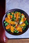 Asparagus salad with oranges, mimolette and lambs lettuce