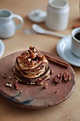 Banana oats healthy pancakes and coffee on the wooden table