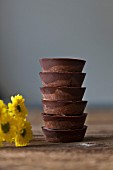 Stack of vegan date chocolate cups