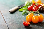 various of colorful tomatoes on wooden background