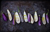 Fairytale Eggplants, Halved on Dark Pan
