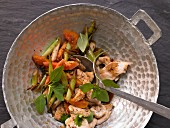 Stir fried chicken with papaya and spring onions