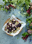 Beetroot, feta and couscous salad with fresh beetroots and pretty foliage