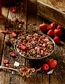 Homemade oat granola with dried strawberries, raspberries and chocolate