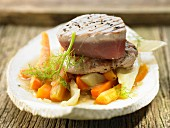 Veal steaks and tuna with fennel and carrot