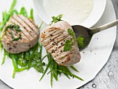 Steamed veal fillet steaks with sugar snaps and chervil
